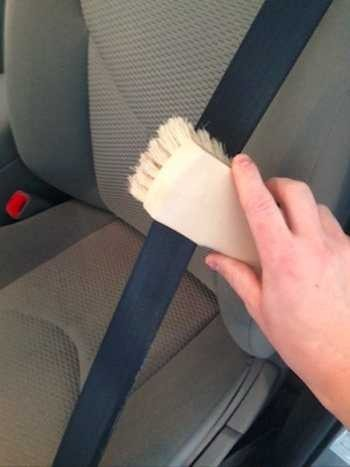Brush along the fibers of your seat belt for best results