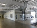 A neat and clean and professional refinishing department is located at Baker Nissan North, Houston, TX, 77065