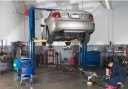 Professional vehicle lifting equipment at Collision King Repair Center, located at Lubbock, TX, 79424, allows our damage estimators a clear view of all collision related damages.