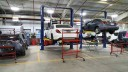 Professional vehicle lifting equipment at Compact Auto Body Inc, located at Matawan, NJ, 07747, allows our damage estimators a clear view of all collision related damages.