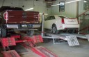 Professional vehicle lifting equipment at Custom Greg's, Inc., located at Oneida, TN, 37841, allows our damage estimators a clear view of all collision related damages.