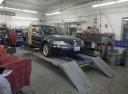 Professional vehicle lifting equipment at Avon Body Shop, Llc, located at Mount Vernon, WA, 98273, allows our damage estimators a clear view of all collision related damages.