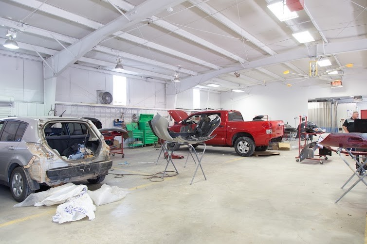 Professional vehicle lifting equipment at Collision Works - Shawnee, located at Shawnee, OK, 74804, allows our damage estimators a clear view of all collision related damages.