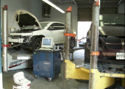 Professional vehicle lifting equipment at Clinton Auto Body, located at Clinton, MD, 20735, allows our damage estimators a clear view of all collision related damages.