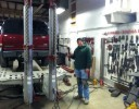 Professional vehicle lifting equipment at South Hill Collision, located at Puyallup, WA, 98375-6621, allows our damage estimators a clear view of all collision related damages.