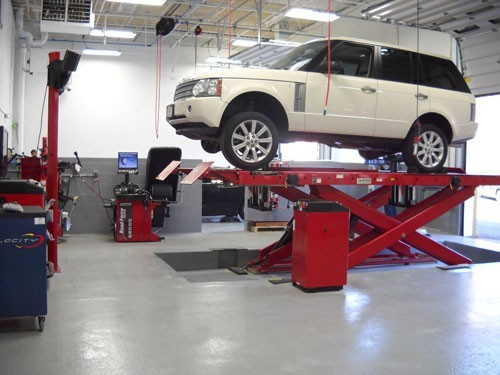 Professional vehicle lifting equipment at Branning Collision Centers - East Brunswick, located at East Brunswick, NJ, 08816, allows our damage estimators a clear view of all collision related damages.