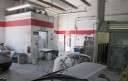 A neat and clean and professional refinishing department is located at Car Guys Collision Repair - Palm Harbor, Palm Harbor, FL, 34684