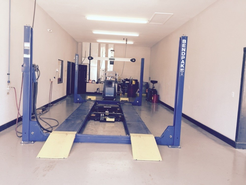 Professional vehicle lifting equipment at Car Guys Collision Repair - Lady Lake North, located at Lady Lake, FL, 32159, allows our damage estimators a clear view of all collision related damages.