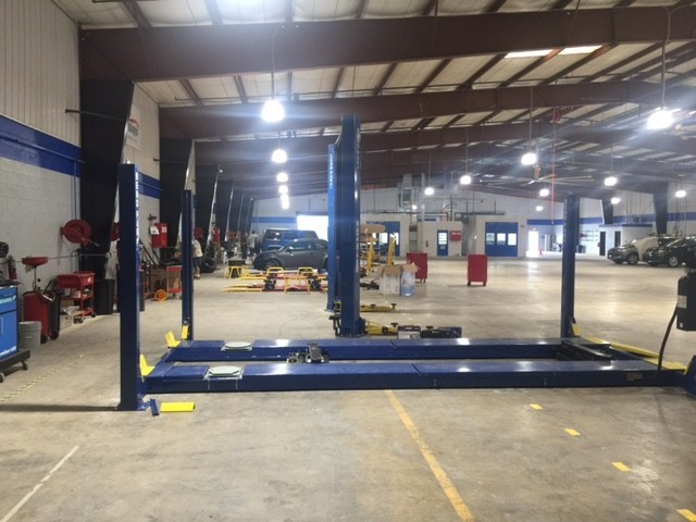 Professional vehicle lifting equipment at Car Guys Collision Repair Ocala East, located at Ocala, FL, 34471, allows our damage estimators a clear view of all collision related damages.