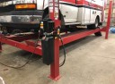 Professional vehicle lifting equipment at Meridian Collision Center, located at Puyallup, WA, 98375-9510, allows our damage technicians a clear view of what might be causing the problem.