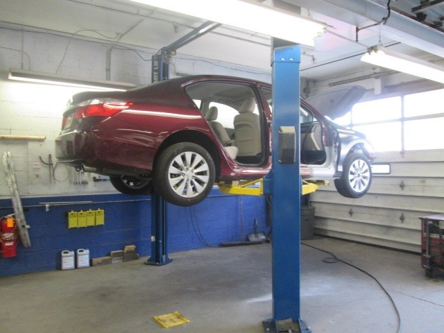 Professional vehicle lifting equipment at Francesco Auto Body, Inc., located at Yonkers, NY, 10703, allows our damage estimators a clePrar view of all collision related damages