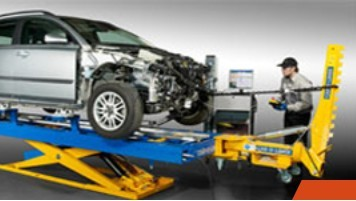 Professional vehicle lifting equipment at Jay's Body Shop, located at El Reno, OK, 73036, allows our damage estimators a clear view of all collision related damages.