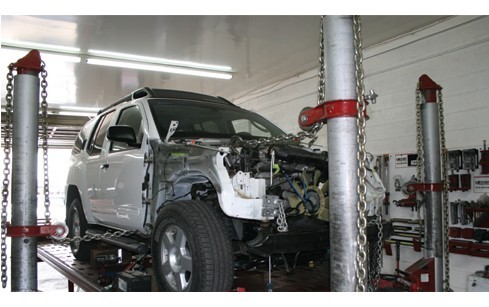 Professional vehicle lifting equipment at Moss Collision, located at Amarillo, TX, 79109, allows our damage estimators a clear view of all collision related damages.