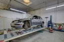 1stCertified Collision Center Moreno Valley - Professional vehicle lifting equipment at 1stCertified Collision Center - Moreno Valley, located at Riverside, CA, 92507, allows our damage estimators a clear view of all collision related damages.