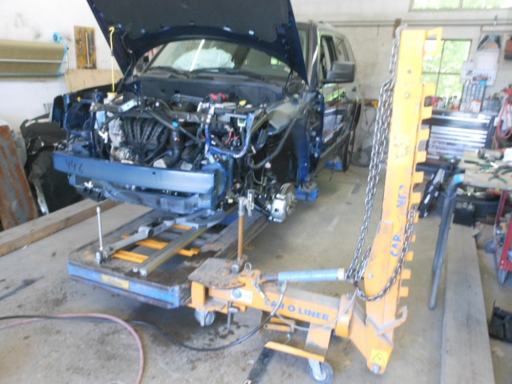 Professional vehicle lifting equipment at Ridgefield Auto Body Inc, located at Ridgefield, CT, 06877-2716, allows our damage estimators a clear view of all collision related damages.