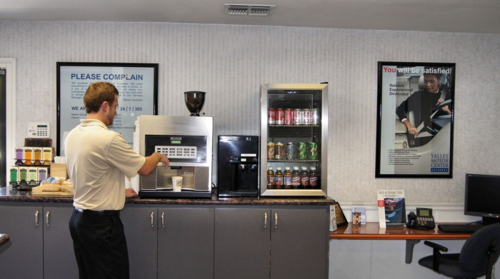 Our body shop's waiting area located at Van Nuys, CA, 91411 has a nice beverage bar.