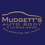 Mudgett's Auto Body Finksburg MD 21048 Logo. Mudgett's Auto Body Auto body and paint. Finksburg MD collision repair, body shop.
