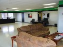 The waiting area at our body shop, located at Leander, TX, 78641 is a comfortable and inviting place for our guests. You can rest easy as you wait for an estimate, or to have your newly repaired vehicle brought around!
