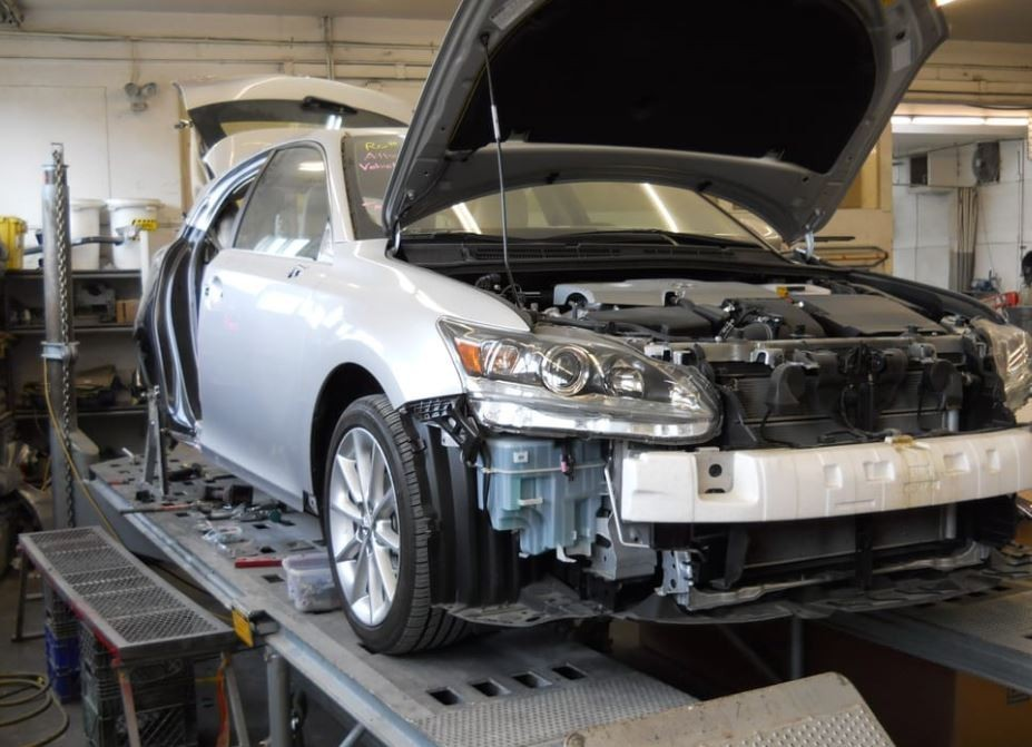 Fix Auto Interbay - Professional vehicle lifting equipment at Fix Auto Interbay, located at Seattle, WA, 98119, allows our damage technicians a clear view of what might be causing the problem.