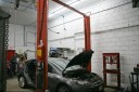 Professional vehicle lifting equipment at Modern Auto Body - South Orange, located at South Orange, NJ, 07079, allows our damage estimators a clear view of all collision related damages.