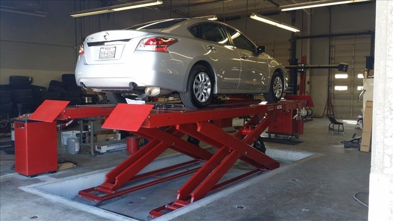 Professional vehicle lifting equipment at Clay Cooley Collision Center, located at Irving, TX, 75062, allows our damage estimators a clear view of all collision related damages.