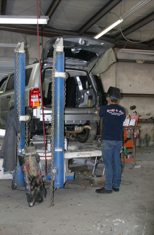 Professional vehicle lifting equipment at Gross & Son Paint & Body Shop, Inc., located at Pensacola, FL, 32505, allows our damage estimators a clear view of all collision related damages.