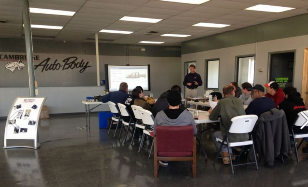 At Cambridge Auto Body, in house training is ongoing.