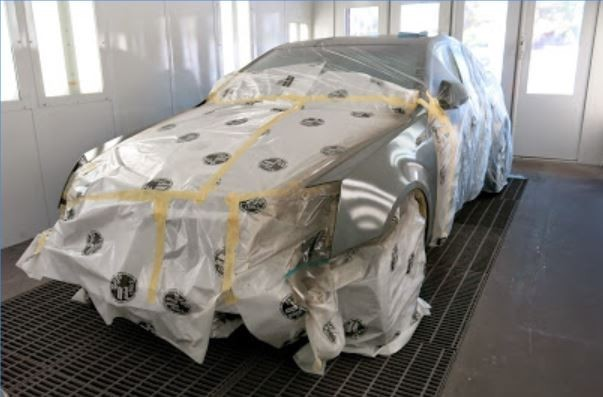 A clean and neat refinishing preparation area allows for a professional job to be done at Fix Auto Phoenix, AZ, 85014.