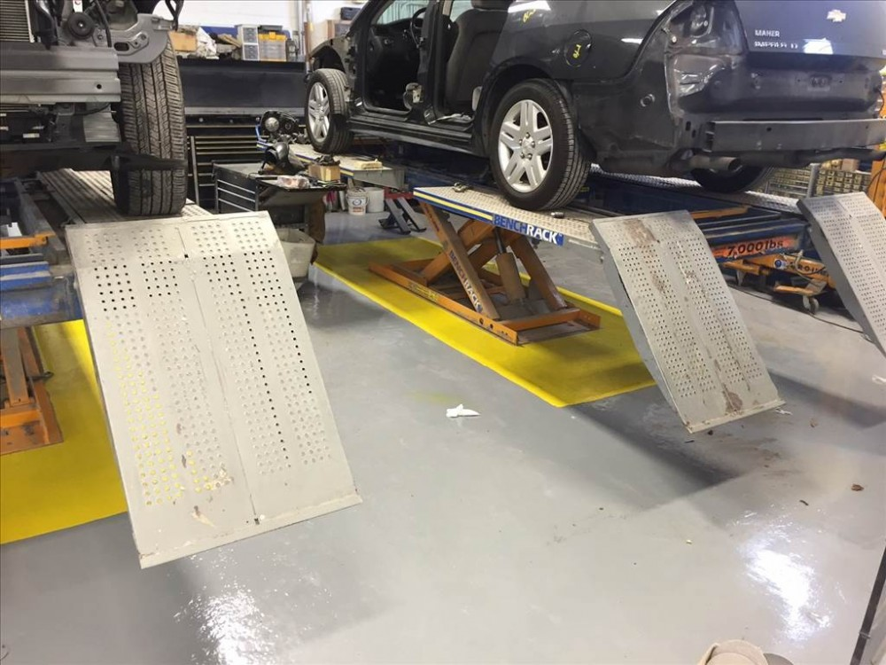 Professional vehicle lifting equipment at Moppert Auto Collision, located at Turnersville, NJ, 08012, allows our damage estimators a clear view of all collision related damages.