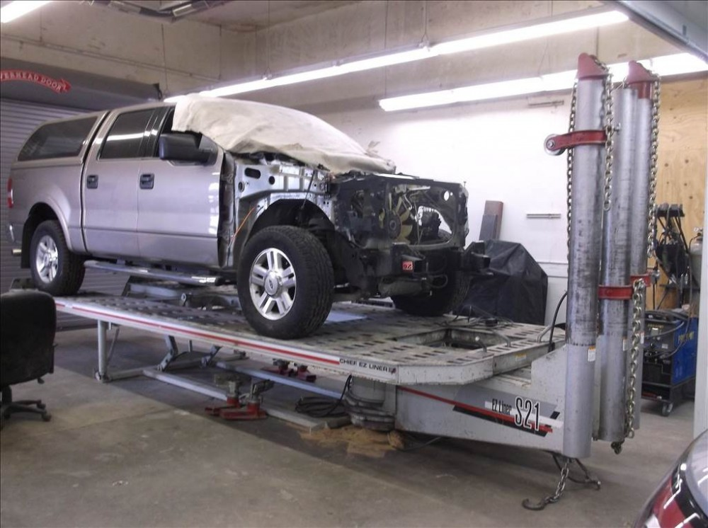 Professional vehicle lifting equipment at Doherty Ford Collision Repair Center, located at Forest Grove, OR, 97116, allows our damage estimators a clear view of all collision related damages.
