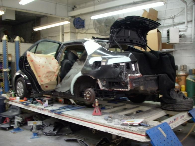 Professional vehicle lifting equipment at Spina & Adams Collision Services, located at Upper Darby, PA, 19082, allows our damage estimators a clear view of all collision related damages.