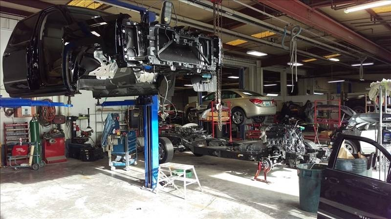 Professional vehicle lifting equipment at St. Matthews Imports - Springhurst Collision, located at Louisville, KY, 40241, allows our damage estimators a clear view of all collision related damages.