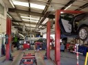 Professional vehicle lifting equipment at Danlar Collision Inc. - Downtown, located at Albuquerque, NM, 87102, allows our damage technicians a clear view of what might be causing the problem.